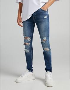Синие супероблегающие джинсы с рваной отделкой и необработанными краями Bershka-Голубой