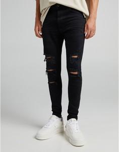 Черные супероблегающие джинсы спрорехами и необработанным краем Bershka-Черный цвет