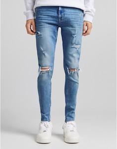 Синие выбеленные супероблегающие джинсы с разрывами Bershka-Голубой