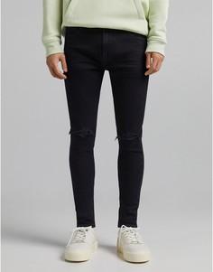 Черные выбеленные супероблегающие джинсы с прорехами Bershka-Черный цвет