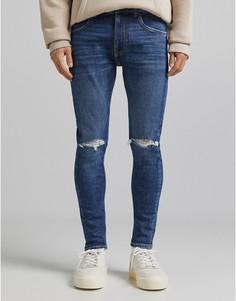 Синие супероблегающие джинсы с рваной отделкой Bershka-Голубой