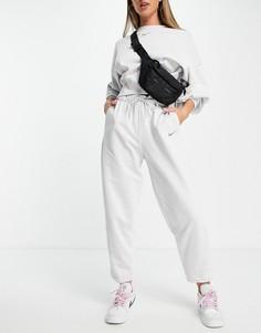 Серые меланжевые брюки из флиса Nike Lounge Essential-Серый