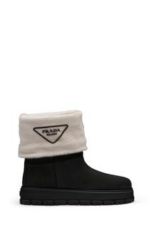 Черно-белые ботинки с мехом Prada