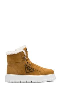 Коричневые кожаные ботинки с мехом Prada
