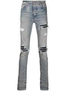 AMIRI джинсы скинни с прорезями и кожаными вставками