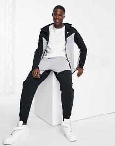 Флисовые джоггеры черного и серого цвета в стиле колор блок Nike Tech-Черный цвет