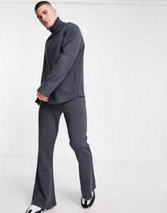 Черные выбеленные расклешенные джоггеры в рубчик зауженного кроя от комплекта ASOS DESIGN-Черный цвет